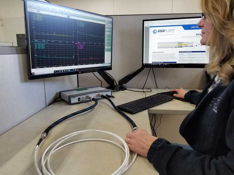 technician using a network analyzer to validate that the RF cable assemblies meet performance specifications